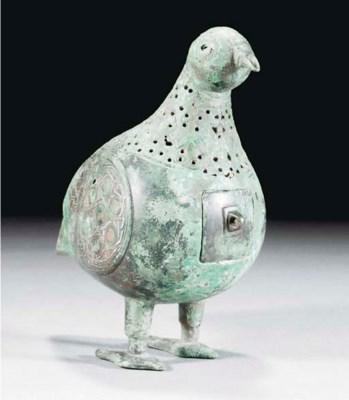 A Seljuk silver inlaid bird ce
