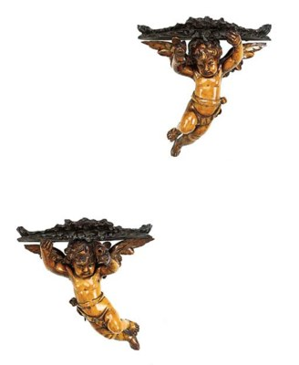 A pair of Italian carved wood