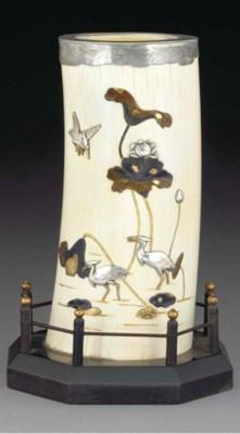 A Japanese ivory silver mounte