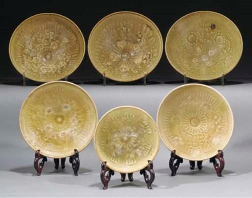 Six Thai carved celadon bowls