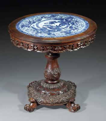 A circular hardwood table with