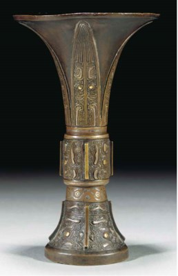 A bronze gu vase inlaid with g