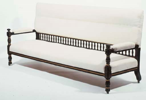 AN EBONISED WOOD SETTEE