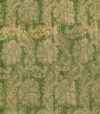 A hanging of green silk damask