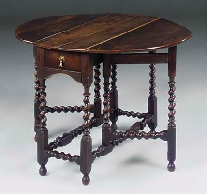 AN ENGLISH WALNUT GATELEG TABL