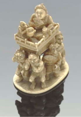 A Japanese ivory netsuke of on