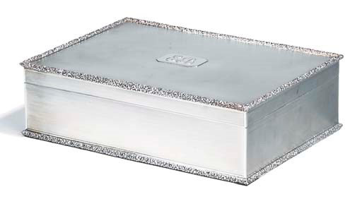 A silver table-top cigarette b