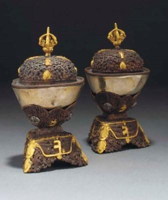 A pair of Tibetan gilt copper