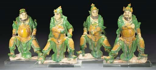 Four Chinese green and ochre g