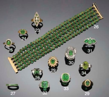 A diamond and emerald marquise