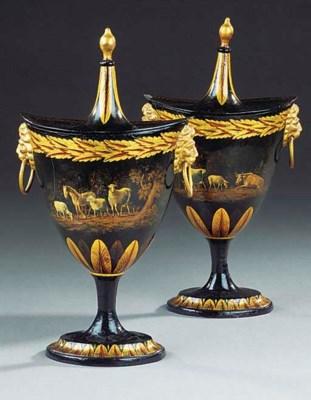 A pair of black and gilt decor