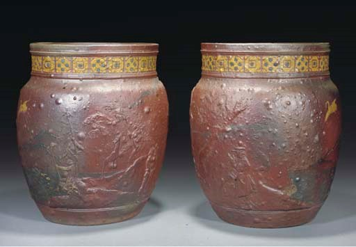 A PAIR OF ENAMELLED POTTERY CA