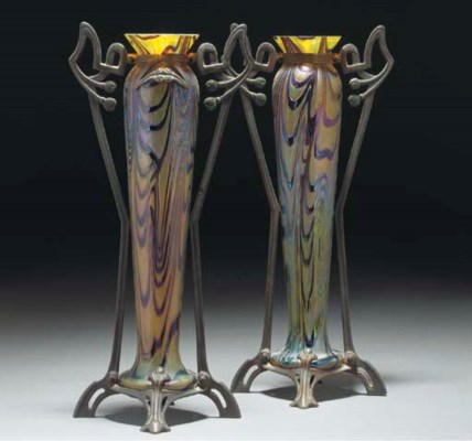 A PAIR OF PATINATED METAL-MOUN