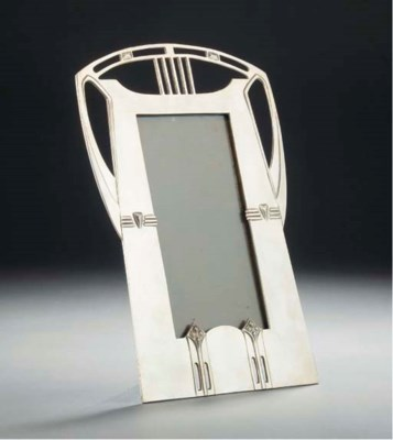 A SILVERED METAL PICTURE FRAME