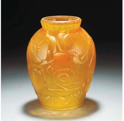 A MOULDED GLASS VASE