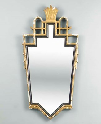 A PART-EBONISED GILTWOOD MIRRO