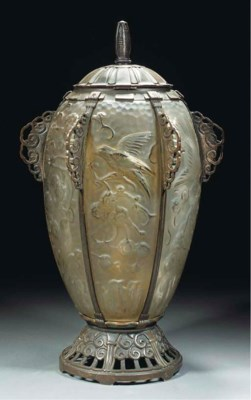 A SILVERED BRONZE AND CLEAR AN