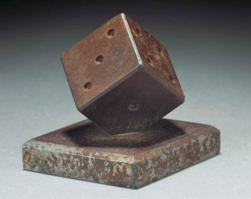 A WROUGHT-IRON PAPERWEIGHT