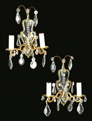 A pair of gilt metal and mirro