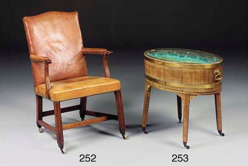 A MAHOGANY OPEN ARM CHAIR