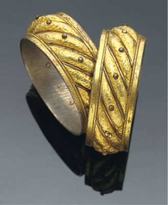 A pair of silver gilt bangles,