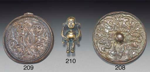 A bronze mirror, Iran, 8th cen
