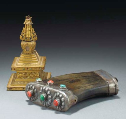 A Tibetan white metal mounted