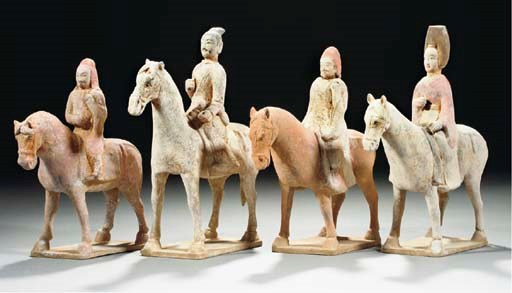 Four painted pottery horses an