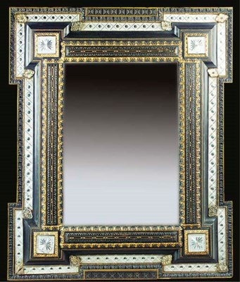 AN ITALIAN EBONISED AND GILT M