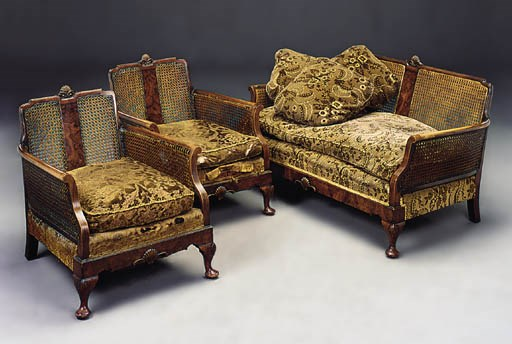A walnut and caned suite