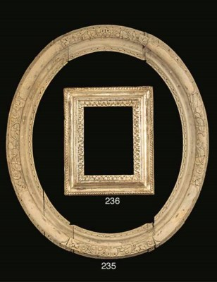 A Louis XIV carved wood oval f