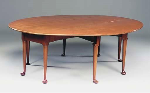 A LARGE MAHOGANY WAKE TABLE