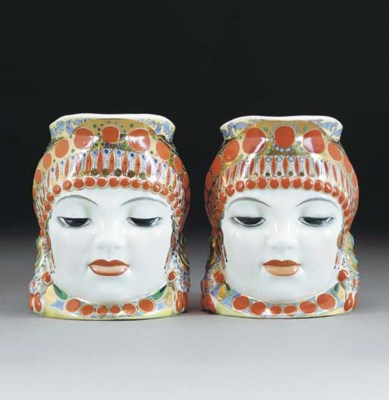 Two Russian face-moulded mugs