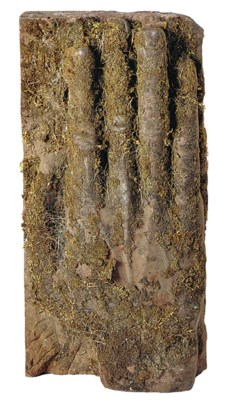 A carved sand stone hand