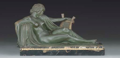 A green-patinated bronze figur