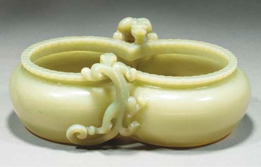 A celadon jade double coupe, 1