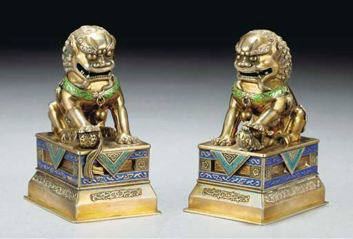 A pair of silver and enamel bu