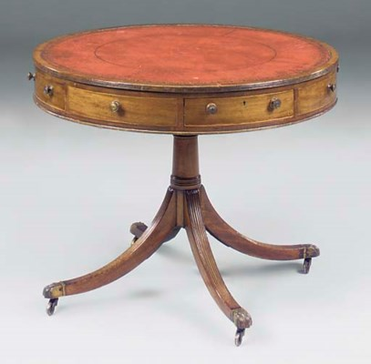 A MAHOGANY LIBRARY DRUM TABLE