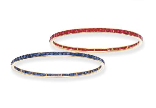 A PAIR OF GEM-SET BANGLES
