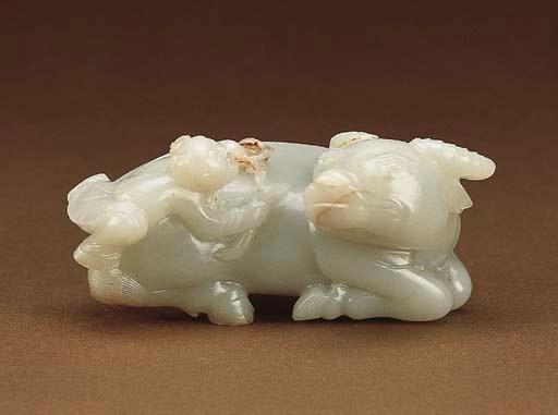 A FINE WHITE JADE BUFFALO AND
