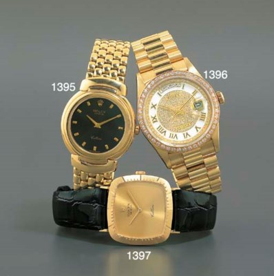 ROLEX. AN 18K GOLD CUSHION-SHA