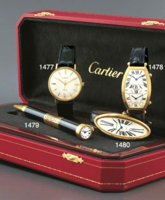 CARTIER. AN 18K GOLD SELF-WIND
