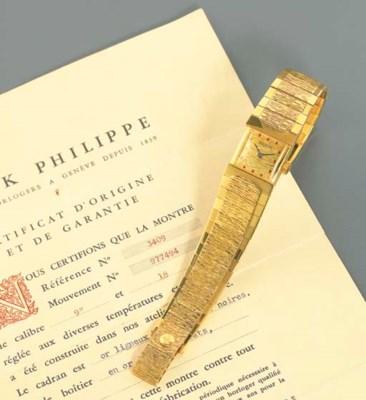 PATEK PHILIPPE. AN UNUSUAL 18K