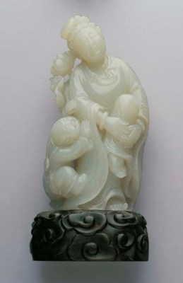 A CARVED NEPHRITE SONGZI GUANY