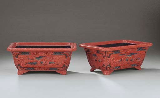 A VERY RARE PAIR OF CARVED LAC