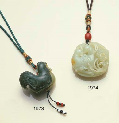 A CARVED NEPHRITE PENDANT