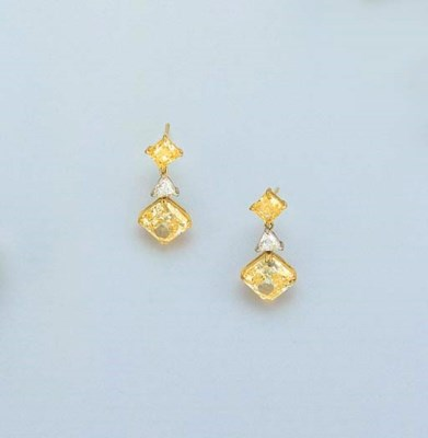 A PAIR OF YELLOW DIAMOND AND D
