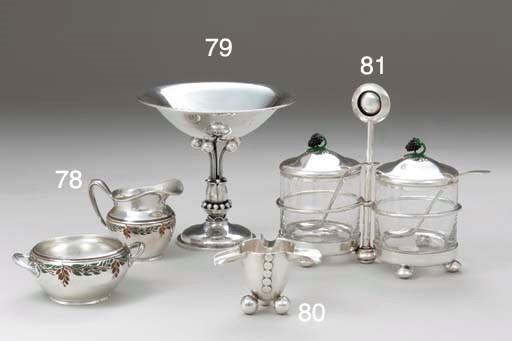A SILVER AND ENAMEL GLASS-MOUN