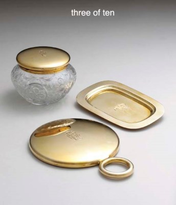 A GOLD TEN-PIECE DRESSER SET,