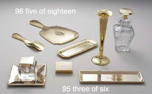 A GOLD EIGHTEEN-PIECE DRESSER